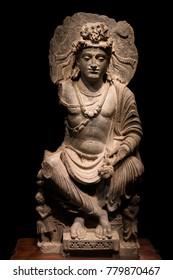 ancient cross-legged Bodhisattva schist statue image in 2nd-3rd century, Kushan dynasty from Mardan, Pakistan.