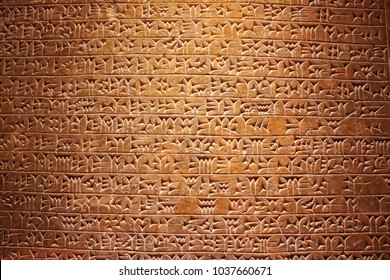Ancient cuneiform writing script on the wall