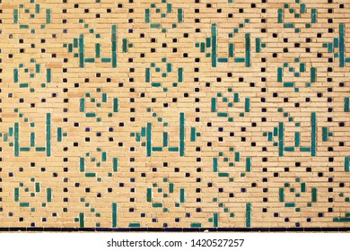 Ancient decorated brick wall in Bukhara, Uzbekistan