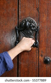Ancient decorative handle with woman hand.
