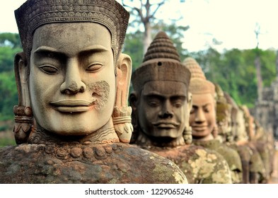 Ancient devas statues carved out of stones depicting the scene of Samudra Manthan at the south gate of Angkor Thom, Siem Reap, Cambodia.