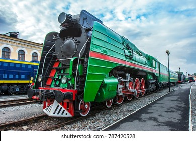 Ancient diesel locomotives. Retro locomotives .. Black locomotive. Green locomotive. Railway and trains.