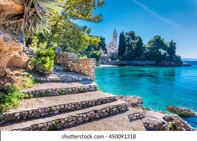 Ancient dominican monastery is landmark in town of Bol with turquoise beach in foreground, Island of Brac, Croatia. Dominican monastery Bol Brac. Selective focus.