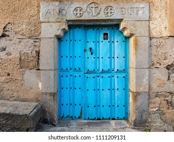 Ancient door dating in 1737 according inscription on the lintel. Old town of San Felices de los Gallegos. Spain.