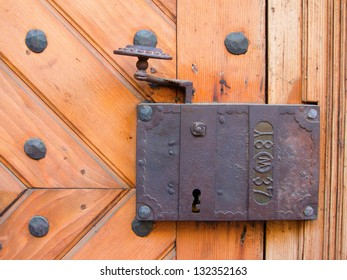 Ancient door lock from a medieval house. With date imprinted