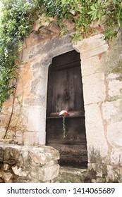 Ancient door in the rain at Tourettes sur Loup ... (France)