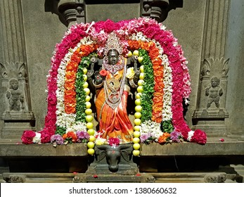 Ancient Durga statue decorated with flowers in the Sri Ramana Ashram in Tiruvanamalai India