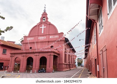 Ancient Dutch colonial buildings Christ church and Stadthuys red buildings are iconic Malacca tourism attractions in Malaysia. No people.