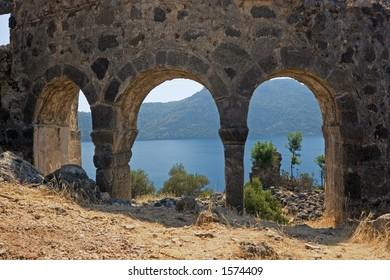 Ancient early Christian church ruins with the Mediterranean behind at St. Nicholas Island, near Fethiye, Turkey