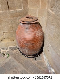 An Ancient Earthenware Jug Near a Stone Wall