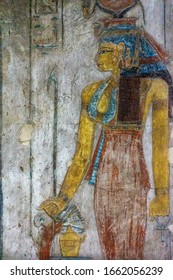 Ancient egypt color image of Egyptian Queen Cleopatra on wall of temple