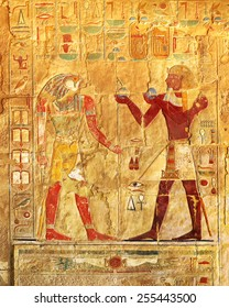ancient egypt color images on wall in luxor - Shutterstock ID 255443500