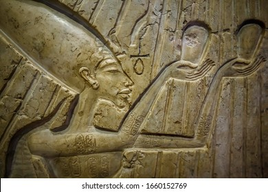 Ancient Egypt stella. Pharaoh Akhenaten & Nefertiti with three princesses worshiping for god Atenu. 16 century BC. Colored limestone. Egypt