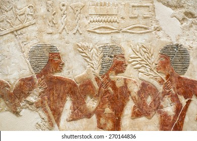 ancient Egypt stone relief with three human figures