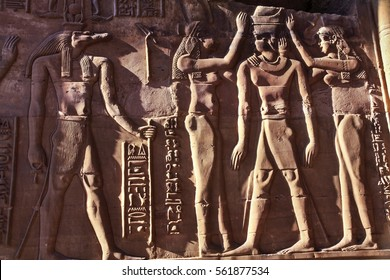 Ancient Egyptian Civilization Mural Tomb Paintings on Walls of Temple of Philae near Valley of the Kings in Luxor Egypt