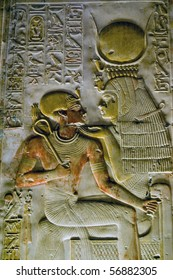 Ancient Egyptian goddess Isis with Pharaoh Seti  Wall of the Temple of Abydos in Egypt.