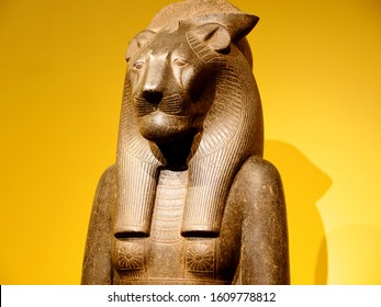 Ancient Egyptian Goddess Statue with Yellow Background