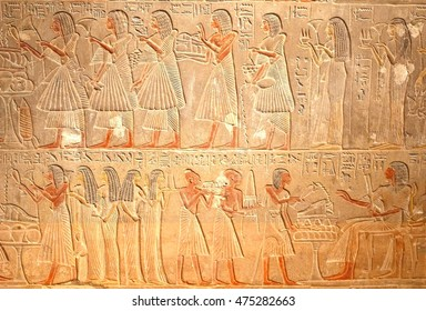 Ancient Egyptian hieroglyphics, stone carving reliefs with elegant women, historic Egypt