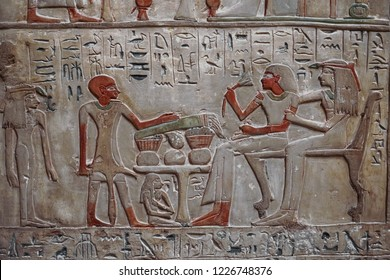 Ancient egyptian hieroglyphs carved on the stone wall in the Karnak Temple, Luxor, Egypt
