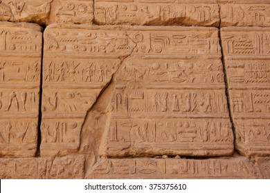 Ancient Egyptian hieroglyphs carved on the stone. The roof of Karnak temple.