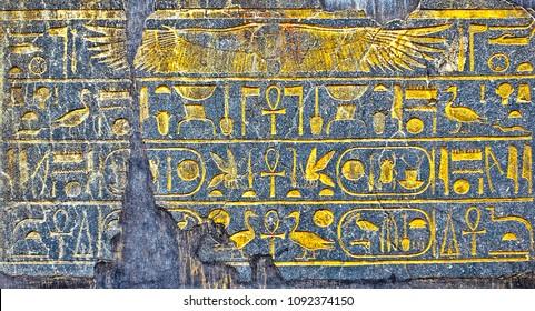 Ancient Egyptian hieroglyphs on stone slabs
