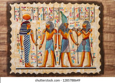 Ancient Egyptian hieroglyphs and silhouettes on papirus