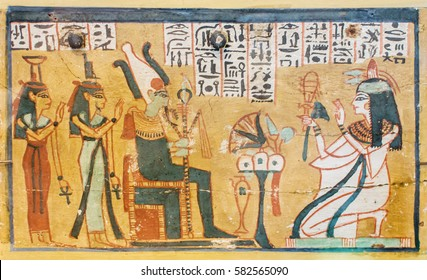 Ancient Egyptian illustration and hieroglyphs engraved and painted on a old stone
