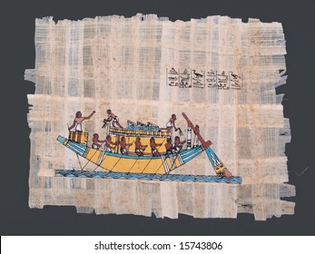 ancient egyptian papyrus with painting of nile boat and hieroglyphs