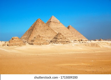 Ancient Egyptian pyramids against a beautiful, cloudless blue sky backdrop in Cairo, Egypt.