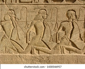Ancient Egyptian relief with prisoners and slaves in Abu Simbel - Egypt