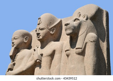 Ancient egyptian statuary art over blue background.
