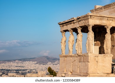 The ancient Erechtheion temple with the beautiful Caryatid pillars on the porch, on the Acropolis in Athens, Greece.