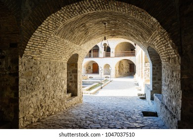ancient European architecture, paved road and stone buildings
