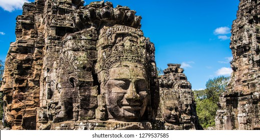 Ancient faces of The Bayon Temple, a Khmer temple, located at Angkor in Cambodia,  built in the late 12th century