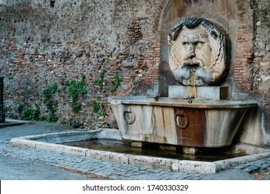 Ancient Fontana del Mascherone near the Church of Santa Sabina on the Aventine Hill