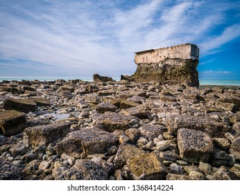 Ancient Fort de l'Heurt in Le Portel, France build at the waterline surrounded by rocks and pebbles