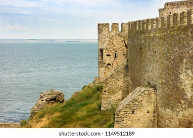 Ancient fortress with loopholes on the seashore
