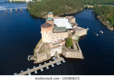 The ancient fortress of Olavinlinna on a sunny July day (aerial photography). Savonlinna, Finland