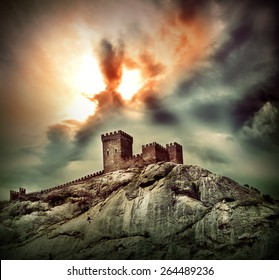 Ancient fortress on the hill under dramatic sky