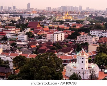 an ancient fortress and The Royal Crematorium of King Rama IX of Thailand  in the evening, Bangkok, Thailand