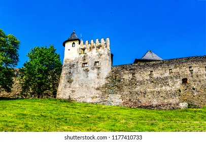 Ancient fortress tower landscape. Fortress wall and fortress tower on blue sky background. Ancient fortress wall view
