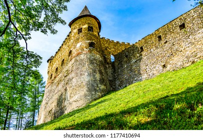 Ancient fortress tower walls view. Fortress wall with fortress tower on blue sky background. Ancient fortress wall view