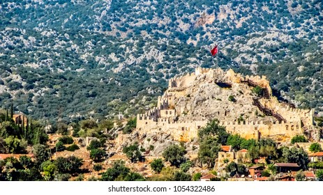 Ancient fortress towering above the old village of Simena in the Kekova district of Antalya province on the Mediterranean coast in Turkey
