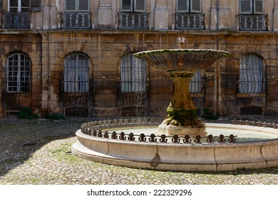 Ancient fountain in old part of Aix en Provence town, South France