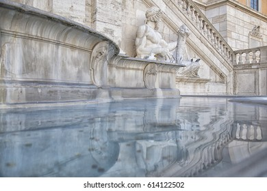 An ancient fountain in Rome, Italy