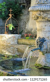Ancient fountain in  Tavel village in the south of France