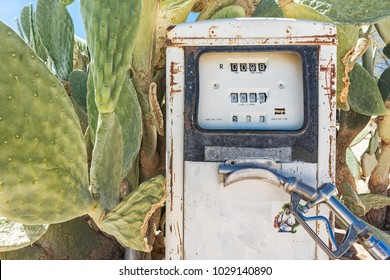 Ancient fuel pump in Namibia desert with cactus