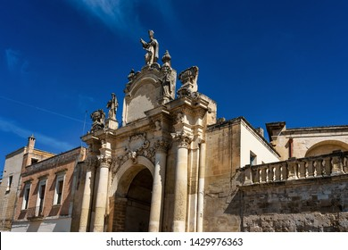 The ancient gate Porta Rudiae with baroque architecture in the historical center of Lecce, Italy on a sunny summer day with blue skies. This is thr oldest gate in Lecce but was rebuilt in 1703.