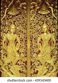 Ancient gold carving wooden door in thai temple.