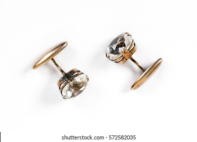 Ancient gold men's cuff links with rock crystal are isolated on a white background
